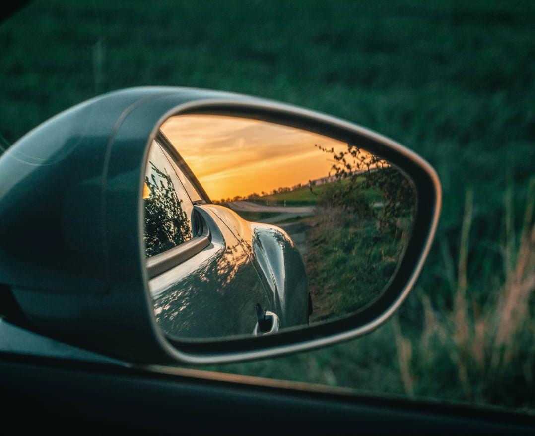 https://www.starglasstucson.com/wp-content/uploads/2021/06/beautiful-sunset-sideview-mirror-car@2x.jpg