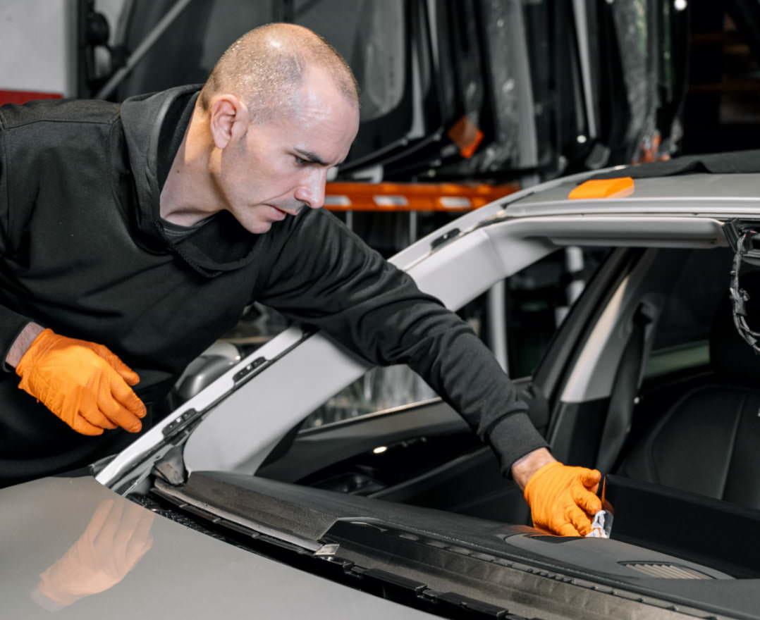 https://www.starglasstucson.com/wp-content/uploads/2021/06/close-up-car-glazing-fixing-repairing-windshield-windscreen-replace-process-car-garage-service-cleaning-dashboard@2x.jpg