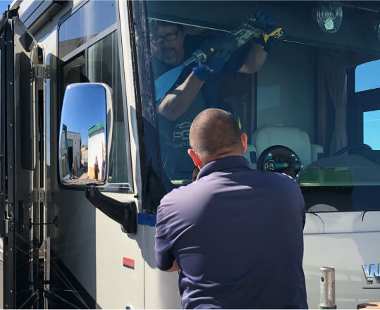 https://www.starglasstucson.com/wp-content/uploads/2021/10/automobile-special-workers-replacing-windscreen-windshield-car-auto-service-station-garage-1.jpg